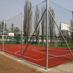 Set of elements for the installation of protective nets on outdoor playgrounds